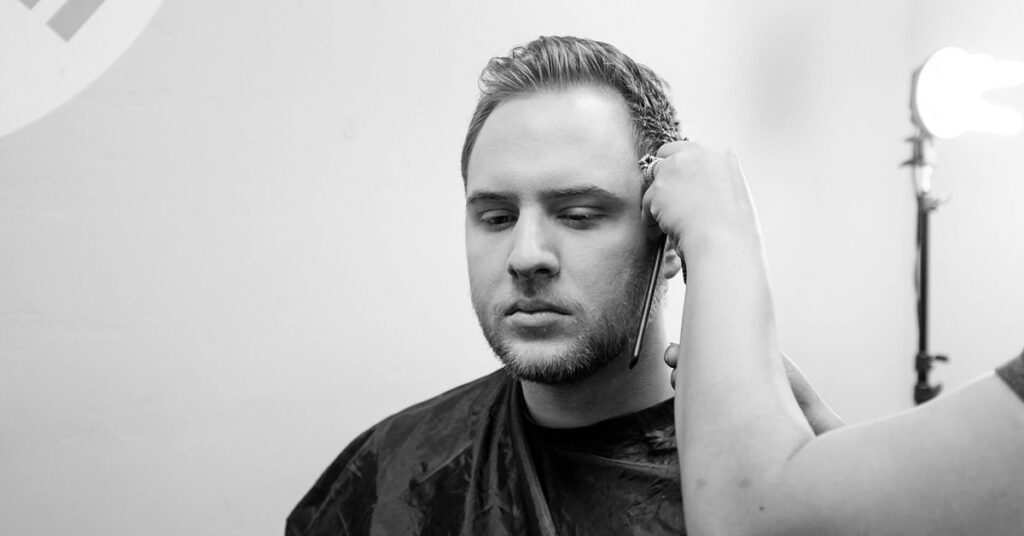 Man having his hair treated