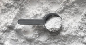 a scoop on top of creatine powder