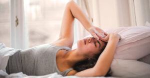 a woman finding it hard to sleep